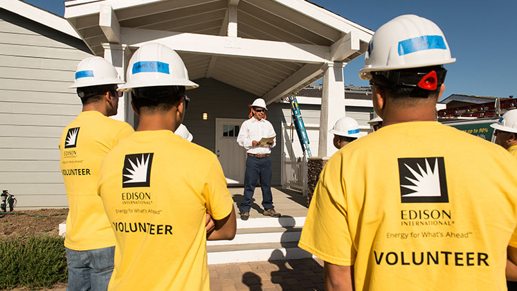 Edison employees are seen at a volunteer event in Chino with Grid Alternatives.